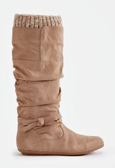 A slouchy knee high boot with a sweater cuff, bow accent, and inner zip closure....