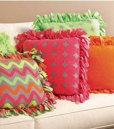"No-Sew Fleece Pillows  If use 18"" pillow form, cut fabric 28"" square and use 5"" square & fringe cuts"