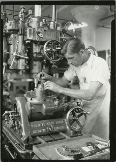 Precision mechanic using depth gauge on a metal boring, 1900-1937
