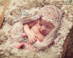 This is an adorable little newborn lacy baby wrap that is fast and easy to knit…