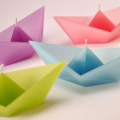 "Origami Floating Boat Candle Favors! 1.5""h x 2.75""l x 1.125""w. Burn time .5 hrs. Boat candles are packed as an assortment of 12 (4 each of 3 colors). Please allow 3-7 days for delivery. ($30)"
