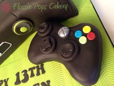 Xbox style game controller cake by Flossie Pops Cakery www.flossiepopscakery.co.uk