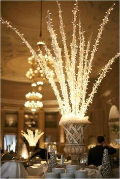 Lit up centre pieces can transform a room. These beautiful twinkly tree centre pieces create the perfect setting for a Grecian style wedding.