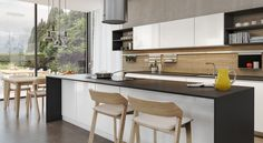 Two-toned cabinets pair nicely with TON Merano counter stools and chairs by Hans Krug