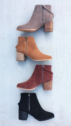 Asymmetrical zip booties in taupe, cognac and bordeaux suede