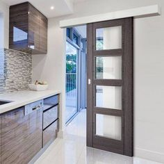 Bespoke Thruslide Surface Vancouver Ash Grey Door with Clear Safety Glass - Prefinished Sliding Door and Track Kit - Lifestyle Image. - March 10 2019 at Kitchen Sliding Doors, Sliding Door Room Dividers, Internal Sliding Doors, Sliding Door Design, Room Divider Doors, Sliding Closet Doors, Sliding Glass Door, Glass Doors, Kitchen Door Knobs