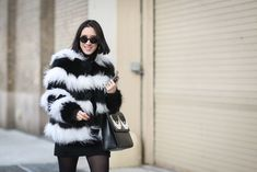 Eva Chen in a striped, furry jacket. Alice and Olivia coat, Les Petits Joueurs bag. #refinery29 http://www.refinery29.com/2015/02/82279/new-york-fashion-week-2015-street-style-pictures#slide-30