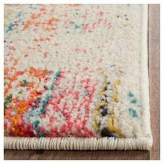 Add a bold splash of color and character to your room's décor with a Safavieh, Blair Rug. This striking accent rug boasts a contemporary tribal pattern and on-trend distressed finish for a look that flawlessly complements your distinct style. Perfect for hard surface floors and high-traffic areas throughout your home. The low-pile construction is soft, durable and effective at trapping dirt. Available in a variety of sizes to expertly fit your floor plan.