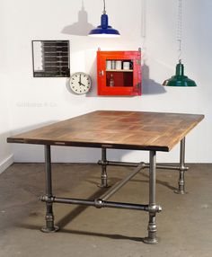 Industrial Pipe Leg Table with Distressed Oak Paneled Top  I'm in love