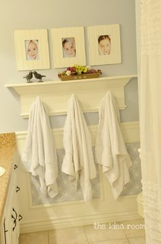 Kids Bathroom: Cute idea to hang their towels under each picture.