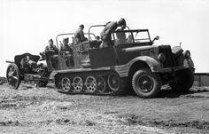 German half-track artillery tractor towing a gun. Russia June 1942