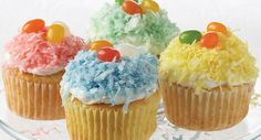 Easter Cupcakes1 package (2-layer size) white cake mix, 1 container (16 ounces) vanilla frosting Flaked coconut, (about 1 cup for each desired color) McCormick® Assorted Food Colors & Egg Dye