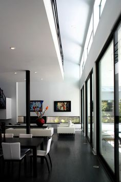 Dark timber floor, black door frames.