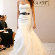 Simple fishtail dress with black belt.