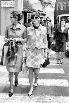 Audrey Hepburn and Lorian Franchetti Gaetani shop in Rome, March 1968. Audrey wears a Givenchyjacket, sleeveless blouse and skirt, from Givenchy's collection for the Autumn/Winter 1967/68. Handbag:Givenchy Shoes:René Mancini
