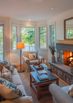 Love this tiny but oh-so-cozy living room in a Maine vacation home. John Cole Architects and designers.