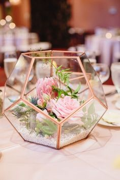 Pretty copper and glass terrariums  with florals and white sand for wedding day centrepieces| WedMeGood|#wedmegood #indianweddings #florals #glassterrariums #tablecenterpieces #weddingdecor #decorelements