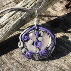 This is a purple and silver clay love pendant with rose quartz accents. Hangs on a faux suede cord with a lobster clasp closure. Rose Quartz is the stone of the heart and of unconditional love. In the shop now link in bio #love #rosequartz #crystalhealing #crystals #gemstones #gemstone #hippie #clay #handmade #shopsmall by hikinghippiehemps