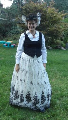 Steamtopia steampunk convention June 2014. This was dubbed my Eliza Dolittle costume. Orginally a size 4 homemcoming dress  thati got for 12.00 from salvation army. I took the skirt apart and remade it tot fit me. the bodice was never going to fit me; sop i cut out the appliqués and refashioned it onto a straw hat.