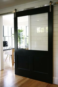 HouseTour:ModernFarmhouse - Design Chic A sliding barn door with a window! I like that you can see the view with the doors closed. Style At Home, Style Blog, Glass Barn Doors, Barn Door With Window, Wood Doors, The Doors, Entry Doors, Patio Doors, Windows And Doors