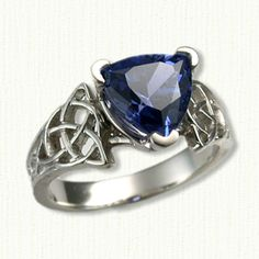 Unique Celtic Engagement & Gemstone Rings: 'CIRCLE TRINITY KNOT' -shown in 14kt white gold set with a trillion cut blue sapphire