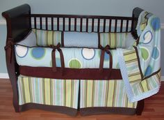 Twisted Stripe Crib Set  This custom baby crib bedding set includes blue green and brown stripe and polka dot bumper with soft blue minky, a tailored stripe box pleat skirt, and coordinating soft blue minky backed blanket.