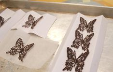 Piped chocolate butterflies: Each set of wing is separately hand piped onto a clear acetate sheet, then allowed to dry. Cupcake Cookies, Cupcake Toppers, Cupcakes, Chocolate Template, Piping Templates, Chocolate Butterflies, Piping Design, Chocolate Showpiece, Cake Writing
