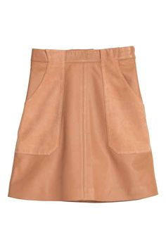 Leather skirt: PREMIUM QUALITY. Knee-length soft leather skirt in a gentle A-line style with suede front pockets, belt loops at the waist and a concealed zip in the side. Lined.
