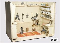 German kitchen ca. 1820 which has undergone several restorations in its life. Size:  80 cm wide, 62 cm tall, 49 cm deep. It has a bread cupboard, goose pen, washstand, nd attached fitted shelves.   The chimney hood was once removed, recess at the upper shelf for the chimney hood is visible, varnish is probably from the '20s.   Under the paintwork is an old paintwork from the Biedermeier factory.