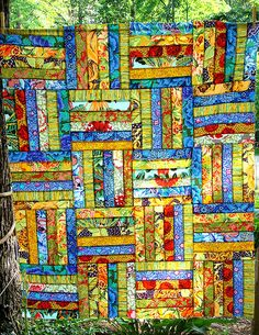 Stained glass look but no sashing but that might just be shadows as this is just the top. Uses some Kaffe Fasset fabrics as well as some others.