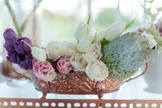 Romantic Copper Metallic & Blush Wedding flower arrangement of tulips and roses! http://www.confettidaydreams.com/copper-metallic-and-blush-wedding-ideas/