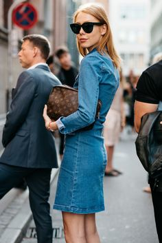 Chic denim dress and timeless Louis Vuitton pouch as seen during Copenhagen Fashion Week