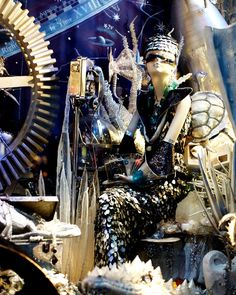 A holiday window at Bergdorf Goodman featuring creatures in a lunar-themed display