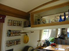 Nice use of the wall space in narrowboat kitchen - galley - interior http://www.sailboat-interiors.com/ http://www.sailboat-interiors.com/store