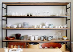 Here's the dilemma: You love the look of an open shelving kitchen, but your home style isn't the farmhouse chic that caters to open shelving. While the open shelves suit the modern farmhouse style, you don't have to redo your… Continue Reading → Stylish Kitchen, Open Kitchen, Kitchen Dining, Kitchen Chairs, Kitchen Redo, Dining Room, Kitchen Shelves, Wall Shelves, Shelf