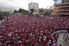 Costa Rica soccer fans fill the street as they celebrate their team's victory over Greece at a Brazil World Cup round of 16 game in San Jose, Costa Rica, Sunday, June 29, 2014.