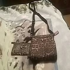 Authenic coach purse Authenic purple and leopard crossbody purse with matching wallet.  Perfect condition. Coach Bags Crossbody Bags