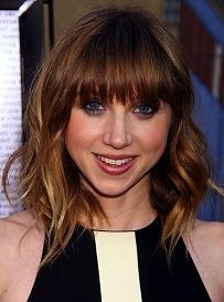 The most modern of all of Deborah Ann's looks is this short, choppy style with big waves and blunt cut bangs. The color is superb with the bleached tips making her look more youthful and bright.