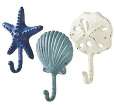 Sea Treasures Wall Hooks - Set of 3 - Antique Weathered Hangers for Coats, Aprons, Hats, Towels, Pot Holders - Scallop, Sand Dollar, Sea Star / Starfish If you love thinking of sands on a beach or the waves of the ocean consider using some beach bathroom decor ideas. When you combine cute beach wall art along with beach themed shower curtains and beach bathroom accessories the ocean has a way of coming to you. Furthermore you can use beach bathroom accessories along side lighthouse decor, n