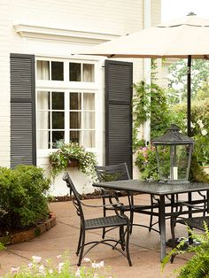 Echo the Exterior - the patio furnishings match the exterior of the home for a classic look. Use lanterns to provide a glow in the evening. LED lanterns are safer than candles and long lasting.