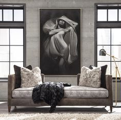 The Huntington House 7253-20 open back sofa is decadent luxury at its best! Here it is shown in a suede-like leather on the outside, distressed fabric on the inside, and velvet and faux fur throw pillows. Its unique cut out back makes it a standout piece and perfect for floating in a room or accompanying a conventional sofa.