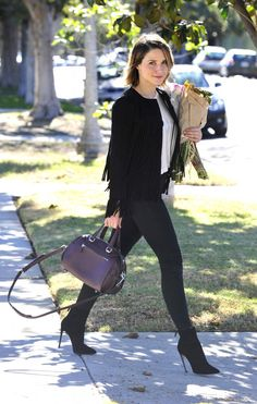 Sophia Bush wearing Coach Ace Satchel, Theperfext April Fringe Suede Jacket and Acne Studios Skin 5 Pocket Mid-Rise Skinny Jeans