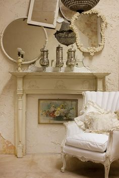 Love this...fab chair, shabby, quirky mirrors, shabby mantle with silver canisters, and like that vintage painting under the mantle!