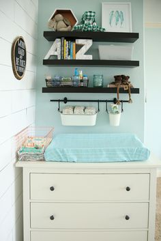 """'I love using the FINTORP system from Ikea to organize above the diaper changing area!"""" Babyrabies.com"""