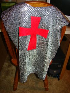 Knight tunic (for armor-of-God party). Rectangular sequined material with hole cut in it for head. Felt cross adhered with Heat-and-Bond. Tie a cord around the waist and... voila! No sewing!