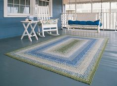 I love the rug...I want a cozy covered porch with a painted deck..