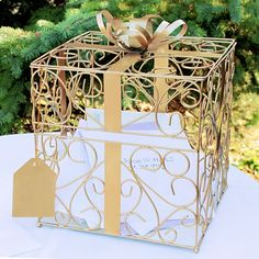 Perfect for any earth tone wedding color theme or a 50th wedding anniversary party,  guests will know just where to deposit your gift cards this 10 x 10 gold scroll reception gift card box featuring ornate metal vine scroll design, shimmering ribbon, bow and gift tag accents. This card box can be ordered at http://myweddingreceptionideas.com/gold_scroll_metal_gift_card_box.asp