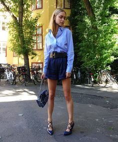 The season's best pairing is the high-waisted short with a simple deluxe shirt—such an easy look to dress up and down! Teisbaek in shorts from Cecilie Copenhagen, shirt from Baum und Pferdgarten, shoes from Ganni, bag from Chanel, and belt from Ganni.
