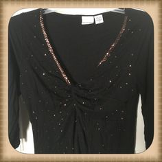 Black top with brown sequins 3/4 sleeve Black 3/4 sleeve top with brown sequins along neckline and on front. Has a cute twist detail in the V-Neck. Newport News Tops Blouses