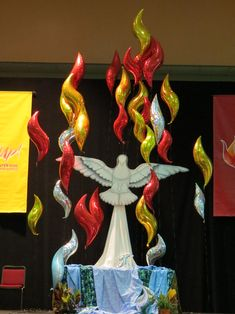 A dove and flames create a floating focal point above the main altar in the plenary hall.